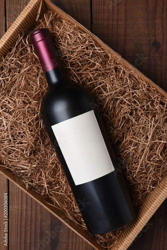 Fotografie, Obraz  Cabernet Wine Bottle in Packing Straw
