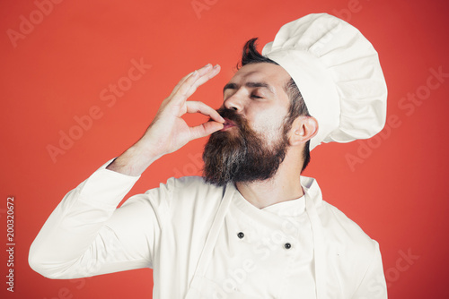 Cuadros en Lienzo Professional chef man showing sign for delicious
