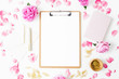 canvas print picture Workspace with clipboard, pastel roses and accessories on white background. Flat lay, top view. Blogger of freelancer concept