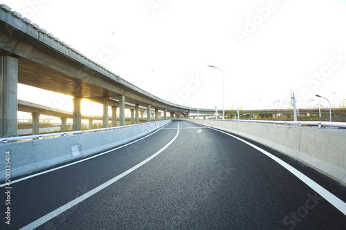 Empty road floor with city overpass viaduct bridge Canvas Print