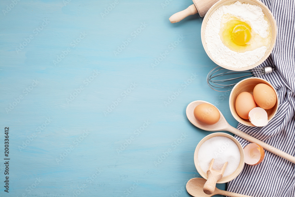 Fototapety, obrazy: Baking utensils and cooking ingredients for tarts, cookies, dough and pastry. Flat lay with eggs, flour, sugar, berries.Top view, mockup for recipe, culinary classes, cooking blog.
