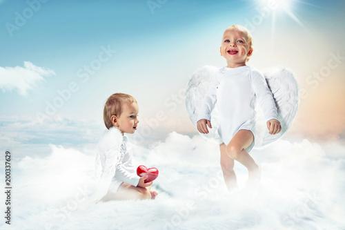 Papiers peints Artiste KB Conceptual portrait of a two cute cupids on the cloud