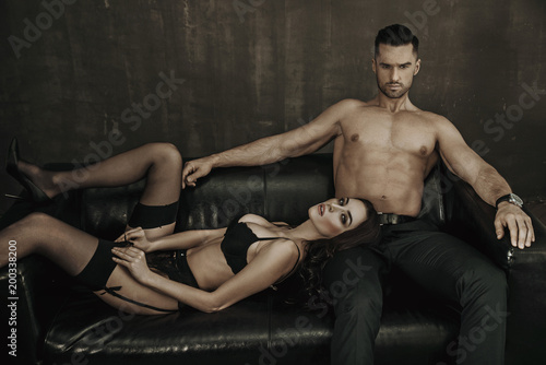 Foto auf AluDibond Artist KB Sensual woman laying on her lover's legs