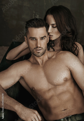 Staande foto Artist KB Sexy woman seducing her handsome, muscular husband