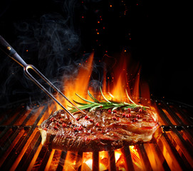 Fototapeta Do steakhouse Entrecote Beef Steak On Grill With Rosemary Pepper And Salt