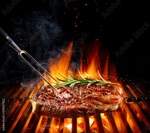 Aluminium Prints Grill / Barbecue Entrecote Beef Steak On Grill With Rosemary Pepper And Salt