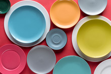 Stacks Of Colorful Porcelain Plates On Red Background