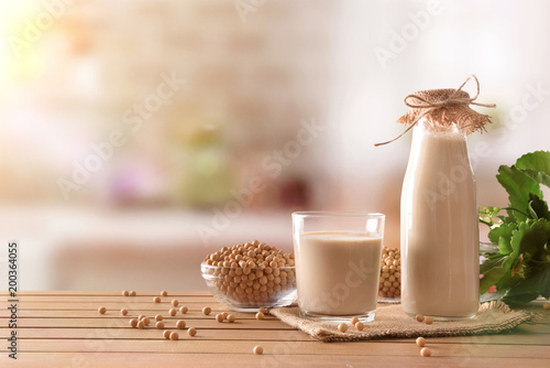 Reptientes with soy milk and grains in rustic kitchen background