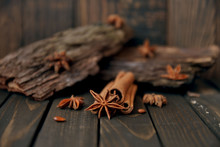 Close-up Of Star Anise With Cinnamon Sticks On Wooden Table. Toned And Art Soft Focus.