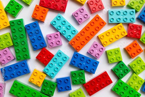 Plastic toy blocks on white background плакат