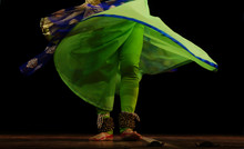 Indian Traditional And Cultural Kathak Style Or Form  Woman Dancer With Bells Tied To Legs