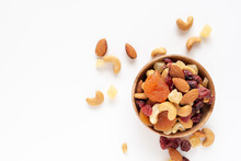 Healthy Snack: Mixed Nuts And Dried Fruits In Wooden Bowl On White Background, Almond, Pineapple, Cranberry, Papaya, Apple, Strawberry, Cherry, Apricot, Casshew.