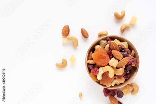 healthy snack: mixed nuts and dried fruits in wooden bowl on