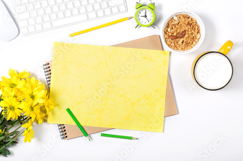 Aluminium Prints Assortment White keyboard, mouse, colorful stationery, yellow flowers, plate with granola and large cup of milk on white background. Concept of healthy nutrition at office. Top view.