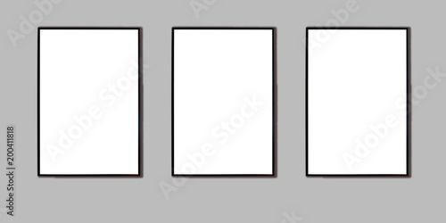 Photo Mock up three black frame for picture, advertisement or poster on a gray wall
