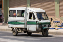 White Electric Car, Minibus Wi...