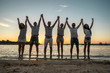 Silhouette of group young people on the beach.