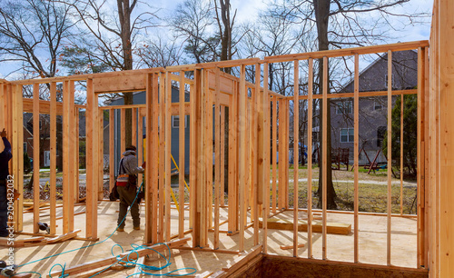 Poster Industrial geb. Interior framing of a new house under construction