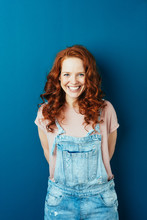 Happy Cheerful Young Redhead W...