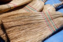 Weaving Brooms At Market