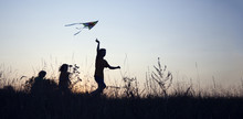 Children Playing Kite On Summe...