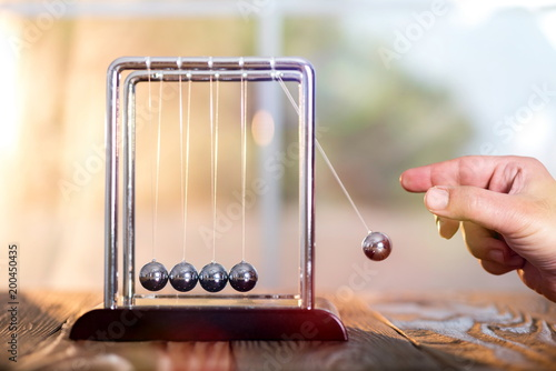 Concept For Action and Reaction in Business With Newton's Cradle Canvas Print