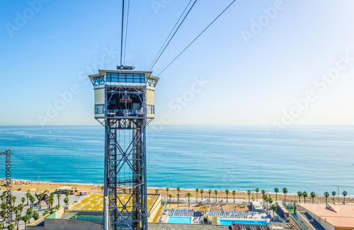 View of the cable car connecting barceloneta beach and montjuic hill in Barcelon Canvas Print