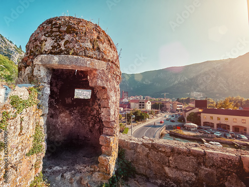 Con. Antique Unusual view of the ruins of the fortification or turret and the beautiful Kotor bay. Fortress wall of Gurdic Bastion, fortifications of Kotor, Montenegro.