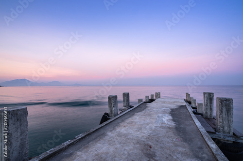 Fotobehang Purper wonderful sky and ocean dock in the sea on twilight sunset time