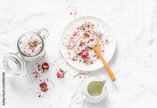 Fototapeta Homemade edible coconut rose sugar scrub on light background, top view