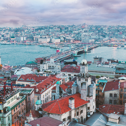 Photo  Panoramic views of the Bosphorus and the old part of Istanbul with lots of mosques at evening