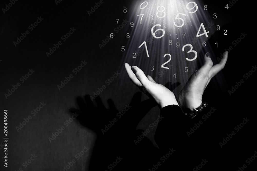 Fototapeta Figures take off from hands, numerology