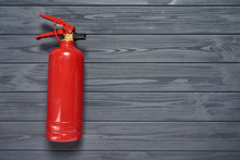 Top View Of Red Fire Extinguisher On Wooden Planks