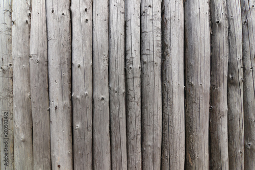 Wall from the wooden poles - Buy this stock photo and