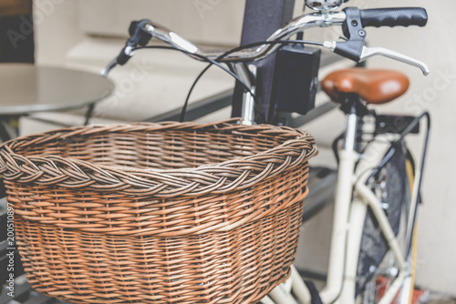 Poster Fiets Healthy transport concept. Vintage bicycle left near cafe with old wooden basket in Italy, Milan. Close up.