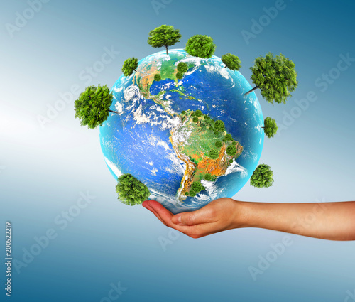Ecological concept of the environment with the cultivation of trees on the ground in the hands. Planet Earth. Physical globe of the earth. Elements of this image furnished by NASA. 3D illustration #200522219