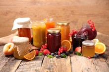 Assorted Jam On Wood Background