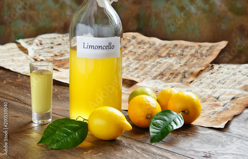 Limoncello homemade on wooden tableI, italian alcoholic beverage