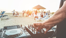 Dj Mixing At Sunset Beach Party In Summer Vacation Outdoor