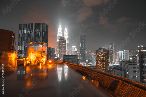 Aerial view at night of skyscrapers in Kuala Lumpur city, Malaysia.