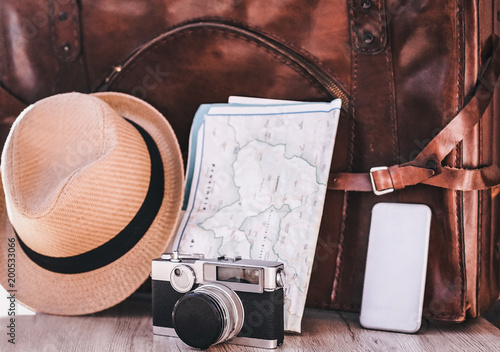 Outfit as vintage photo-camera, hat, map and smartphone of traveler - Essential Fototapeta