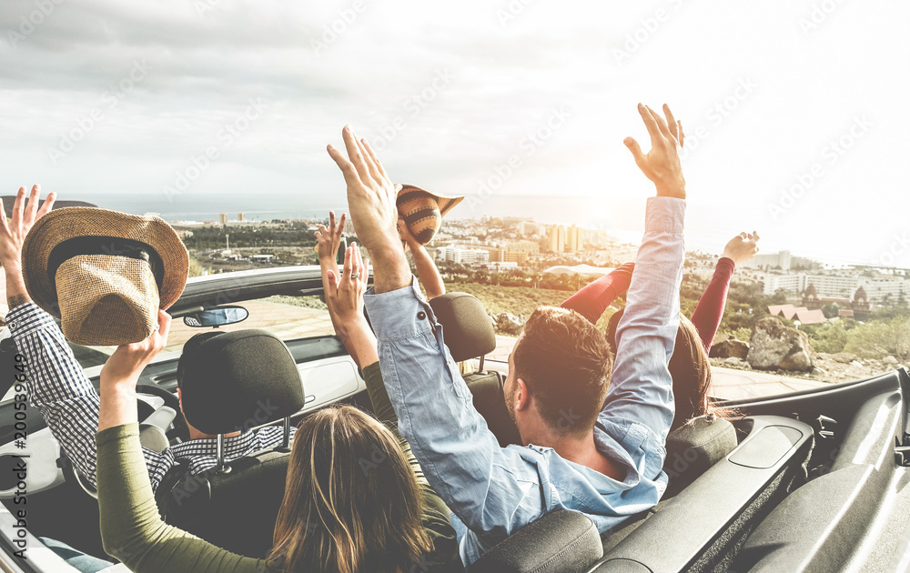 Fototapety, obrazy: Happy friends with hands up having fun in convertible car on summer vacation