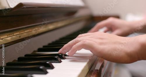 Poster Yoga school Man playing piano at home