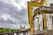 Two ancient and historic churches of the city of Ouro Preto on their hills and in different planes showing the diversity of old churches in colonial style present in the city