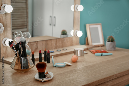 Decorative cosmetics and tools on dressing table near mirror in makeup room Fototapeta