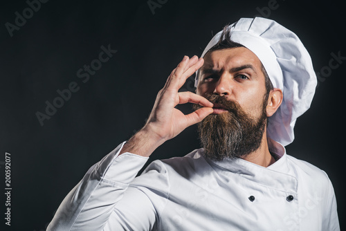 Obraz na płótnie Serious bearded chef, cook or baker gesturing excellent