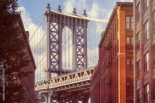 Fototapeten New York Famous view of the Manhattan Bridge from an old street in Brooklyn