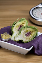 Sliced Artichoke With Fish Oil Capsules And Scale