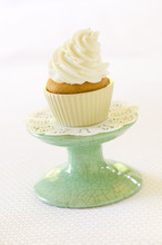 Vanilla Cupcake With White Frosting On Cake Stand