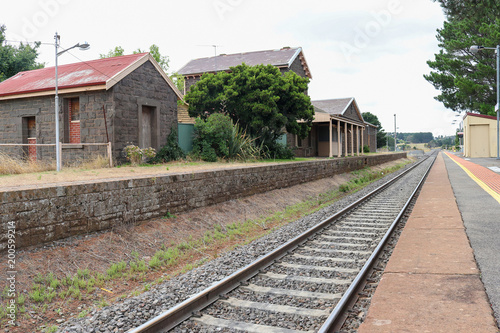 Papiers peints Gares train tracks and a bluestone railway station buildings and platform